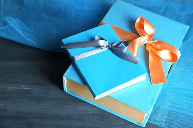 Books wrapped with color ribbon,